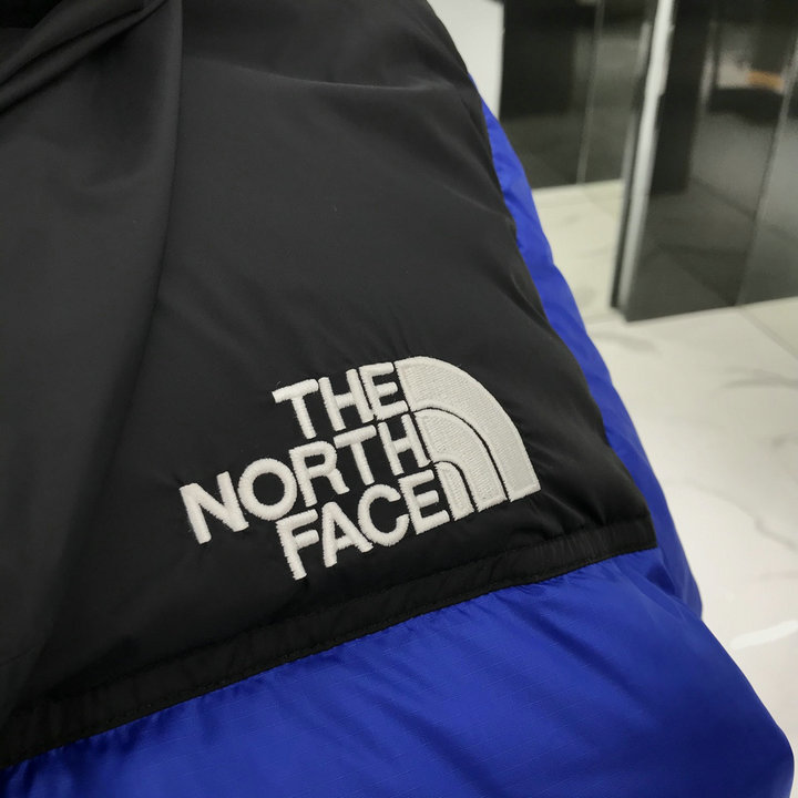 The North Face men's and women's down jacket